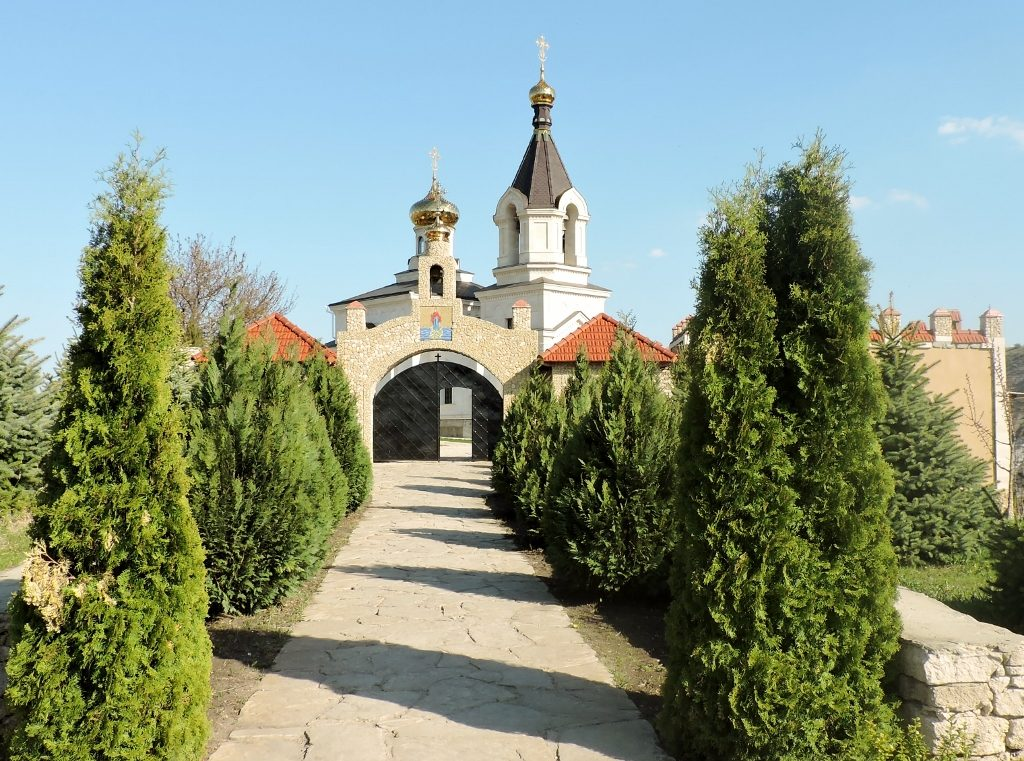 a church with trees in front, Moldova