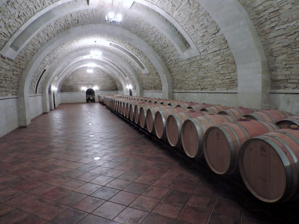 Moldova wineries wine barrels in a cellar