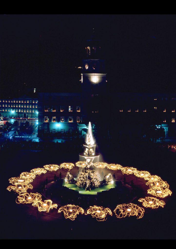 beautiful illuminated fountain at night, tradition meets modernity Salzburg