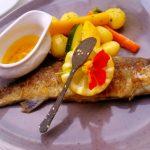 Fischgericht auf dem Teller